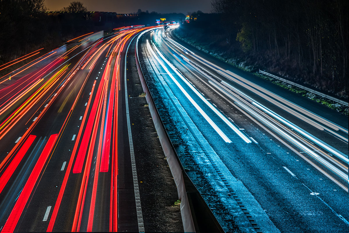 Motorway at night with light trails