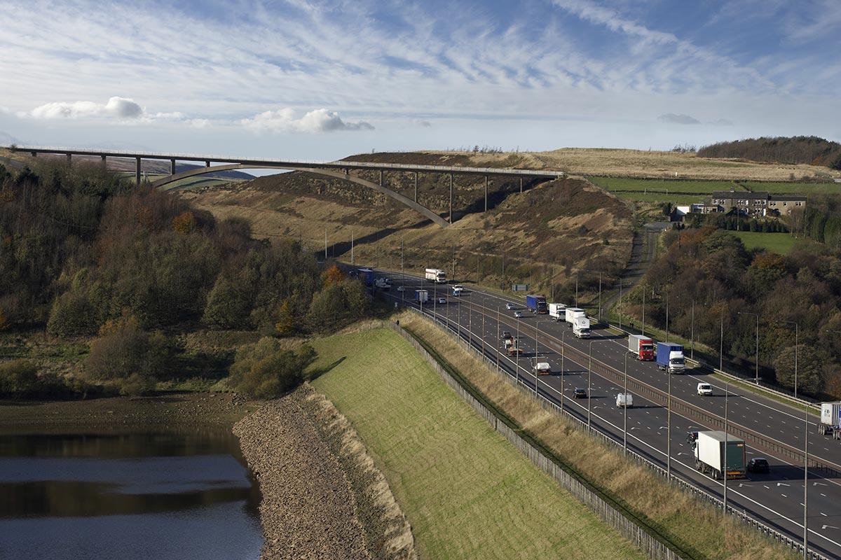 motorway with bridge in background